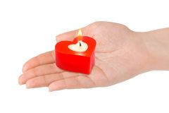 Heart shaped candle in hand Royalty Free Stock Photography