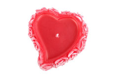 Heart-shaped candle with roses stock image