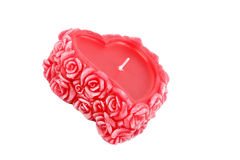 Heart-shaped candle with wax roses Stock Photography