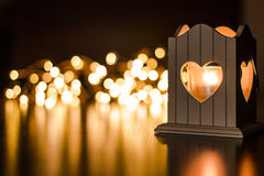 Heart-shaped candlelight. With bokeh lights in the background royalty free stock images