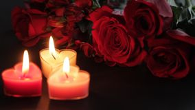 Heart-shaped candles and roses. Static shot of Valentines Day items in hd stock video footage
