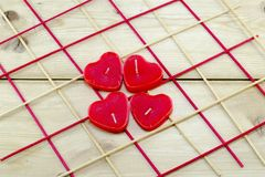 Heart shaped candles on a wooden table Royalty Free Stock Photography