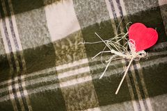 Heart shaped candy. Red heart-shaped candy on the checked plaid Stock Photo