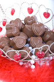 Heart-shaped candy in basket Stock Image