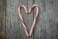 Heart shaped Candy Canes on a Rustic wood Royalty Free Stock Photos