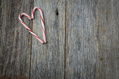 Heart shaped Candy Canes on a Rustic wood Stock Photography
