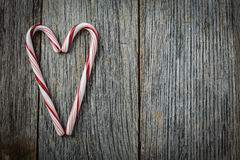 Heart shaped Candy Canes on a Rustic wooden Stock Photo