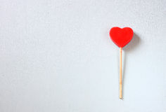 Heart shaped candy over blue wooden board Royalty Free Stock Photography