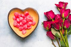 Heart shaped candy and rose royalty free stock images