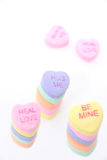 Heart Shaped Candy Stacks (8.2mp Image). Stacks of heart shaped candies which read hug me, eal love and be mine. Main focus on hug me. Shot with the Canon 20D stock photo