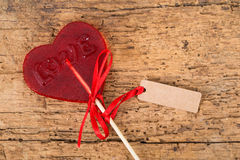 Heart shaped candy on wood Royalty Free Stock Photography