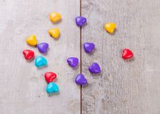Heart shaped candy on wooden background Royalty Free Stock Photography