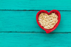 Heart shaped ceramic bowls with pumpkin seeds Royalty Free Stock Images