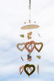 Heart shaped ceramic wind mobile hanging with defocused blue sky Royalty Free Stock Images