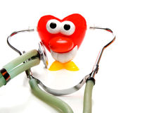 Heart shaped character with stethoscope Stock Photos
