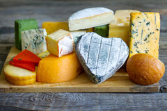 Heart shaped cheese on old boards colorful food abstract Stock Images