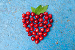 Heart shaped cherries on blue background cherry heart Royalty Free Stock Photo