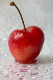 Heart shaped cherry with drops of water Stock Images