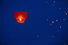 Heart-shaped chinese lantern in the night sky royalty free stock images