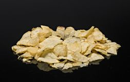 Heart shaped chip on top of chips pile. Stock Images
