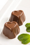 Heart shaped chocolate. And mint leaf royalty free stock photo