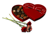 Heart shaped chocolate box and carnations. Stock Photography
