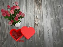 Heart shaped chocolate box and flower vase royalty free stock images