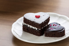 Heart shaped chocolate cake. On white dish Royalty Free Stock Photography