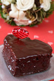 Heart shaped chocolate cake with heart decoration. And bouquet Stock Photo