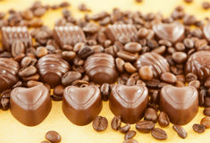 Heart shaped chocolate candies and coffee beans Royalty Free Stock Photos