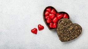 Heart shaped chocolate candies in gift box stock photos