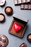 Heart shaped chocolate candy in a gift box on slate background. Top view. royalty free stock photos