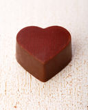 The heart-shaped chocolate candy Stock Images