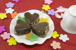 Heart shaped chocolate cookies on a plate Stock Photography