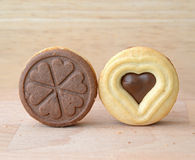 Heart shaped chocolate cookies on wooden plate Royalty Free Stock Image