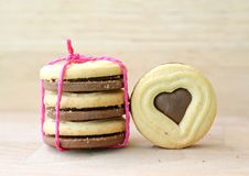 Heart shaped chocolate cookies on wooden table. Royalty Free Stock Photography