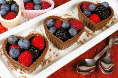 Heart shaped chocolate cups filled with fresh berries Royalty Free Stock Photography