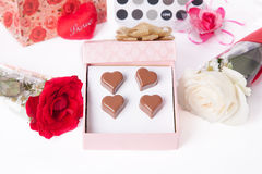 Heart Shaped Chocolate Love in pink gift box and Roses Valentines Day Stock Image