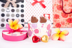 Heart Shaped Chocolate Love in rounded gift box with flower Valentines Day. Picture of Heart Shaped Chocolate Love in pink gift box and Roses Valentines Day with Royalty Free Stock Photos