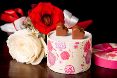 Heart Shaped Chocolate Love in rounded gift box with roses Valentines Day. In black background Stock Photography