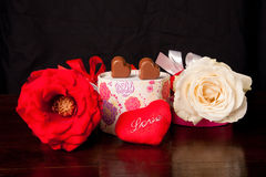 Heart Shaped Chocolate Love in rounded gift box with roses Valentines Day. In black background Stock Images