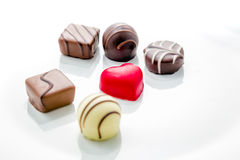 Heart shaped chocolate with other confectionery around Stock Photos