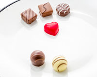Heart shaped chocolate with other confectionery around Royalty Free Stock Photography