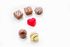 Heart shaped chocolate with other confectionery around Royalty Free Stock Photos