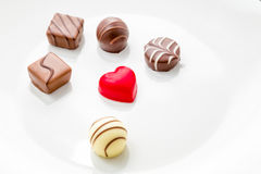 Heart shaped chocolate with other confectionery around Royalty Free Stock Image