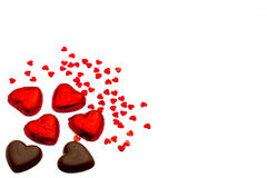Heart-shaped chocolate pieces and small heart-shaped deco articles Stock Photos