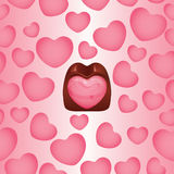 Heart shaped chocolate praline background Royalty Free Stock Photography