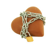 Heart shaped chocolate tied up with chains Stock Images