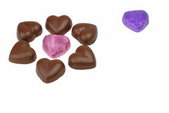 Heart shaped chocolates. Heart shapes chocolates over white background with copyspace Stock Image