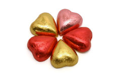 Heart shaped chocolates in color wrappings stock photo